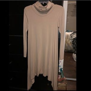 Loose neck, long sleeve dress.